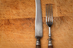 Antique cutlery. On a wooden board Stock Photography