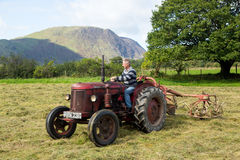 Antique David Brown tractor and threshing machine stock images