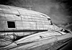Antique DC-3 aircraft. A dramatic photo of an antique DC-3 aircraft that was used to carry Air Mail in a bygone era Royalty Free Stock Image