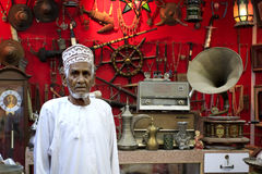 Antique dealer in Mutrah Souk. Muscat, Oman - March 26, 2013: Unidentified Antique dealer in Mutrah Souk Royalty Free Stock Photo