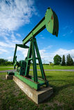 Antique, Decomissioned Oil Pumpjack on Display Stock Photos
