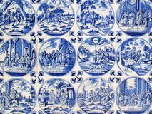 Antique Delft wall tiles. Close -up of Antique tin glazed blue Delft wall tiles dating from 1750-80, showing biblical scenes Stock Photos