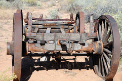 Antique desert wagon. Old wooden wagon with large iron wheels royalty free stock photo