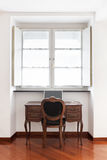 Antique desk with chair Royalty Free Stock Image