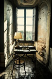 Antique desk. Historical lectern in front of a window. Antique retrò desk and chair. Historical vintage lectern in front of a window in an ancient castle stock photos
