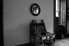 Antique desk in home. Black and white closeup of antique desk in old fashioned home Royalty Free Stock Photo