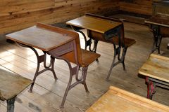 Antique desks in classroom Stock Photo