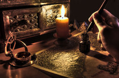 Antique desktop. Still life of desktop with pen and ink, candle,map and sand glass.  Antique setting Stock Photos