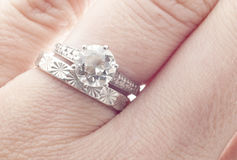 Antique Diamond Wedding Ring and Band on Finger. Macro Close Up Stock Images