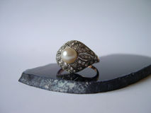 Antique diamonds ring. Antique gold ring , art deco with pearl and diamonds royalty free stock photo