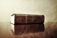Antique Dictionary on Desk Royalty Free Stock Photography