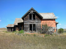 Antique Dilapidated Brick House. Old Falling Apart Gray House in Sims, North Dakota, built with custom bricks, a Historic Home stock photo