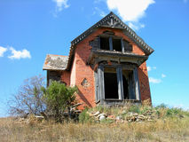 Antique Dilapidated Brick House. Old Falling Apart Gray House in Sims, North Dakota, built with custom bricks, a Historic Home royalty free stock photos