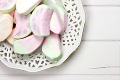 Antique dish with marshmallow sweets Stock Photo