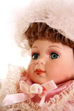 Antique Doll. In white feather hat and pink and white lace dress Royalty Free Stock Images