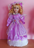 Antique doll. With big eyes in beauty dress Royalty Free Stock Images