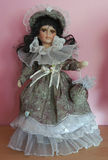 Antique Doll. Doll with big eyes, dressed in beautiful clothes Stock Photos
