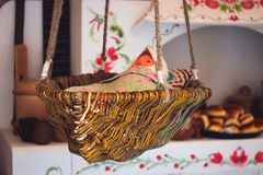 Antique doll lying in a wooden cradle. Antique doll lying in a wooden vintage cradle Stock Photography