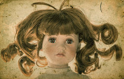 Antique doll. Vintage toy. Retro toned picture. Antique doll. Vintage toy. Retro style toned picture with grange texture Royalty Free Stock Image
