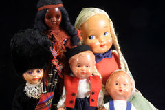Antique dolls. Group of antique dolls on black background Stock Photo