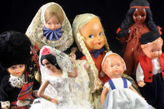 Antique dolls. Group of antique dolls on black background Royalty Free Stock Image