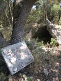 Antique dolmen. A sign next to a dolmen,erected 2800 years before Christ,near the town of St Jean du Pin in the south of France Stock Images