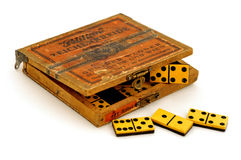 Antique dominoes on white background Royalty Free Stock Image