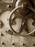 Antique Door. Old iron door handle on a decorated door Royalty Free Stock Photos