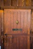 Antique Door with Brass Knocker Stock Photo