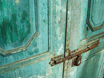 Antique door with chipped blue paint and rusted lock Stock Image
