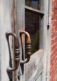 Antique door handles on glass pane doors Stock Images