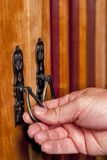 Antique door handles opening Royalty Free Stock Photos