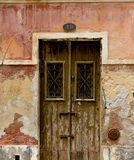 Antique door in a house with worn stone wall texture. Royalty Free Stock Photography