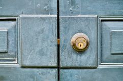 Antique door knob on a vintage wooden door royalty free stock photos