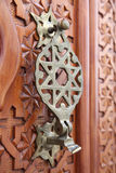 Antique door knocker. In Cordoba, Andalusia Spain Royalty Free Stock Photography