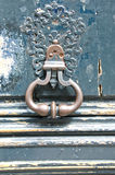 Antique door-knocker on old door Stock Photography