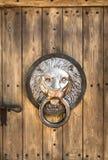 Antique door knocker shaped lion's head. Royalty Free Stock Image