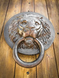 Antique door knocker shaped lion's head. Royalty Free Stock Images