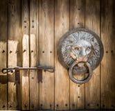 Antique door knocker shaped lion's head. Stock Photography