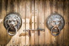 Antique door knocker shaped lion's head. Stock Photo