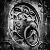 Antique door knocker shaped monster's head. Stock Image