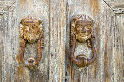 Antique door knockers in Greek island Royalty Free Stock Photography