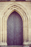 Antique door in lineal gothic arch with vintage treatment. Antique metallic door in lineal gothic arch with vintage treatment Stock Photos