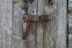 Antique door lock, wooden door Stock Photography