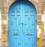 Antique door in     morocco africa blue wood and metal rusty Royalty Free Stock Photos