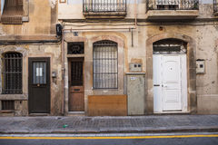 Antique door and old wall in the street. Royalty Free Stock Photography