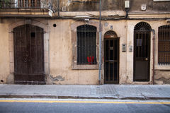 Antique door and old wall in the street. Stock Photos