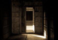 Antique door. Door in one corner of the wooden house Royalty Free Stock Images
