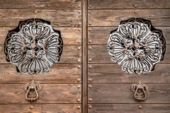 Antique door with vintage iron insertion Royalty Free Stock Photography