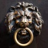 Antique doorknocker. Antique lion's head doorknocker in Aachen, Germany Stock Image